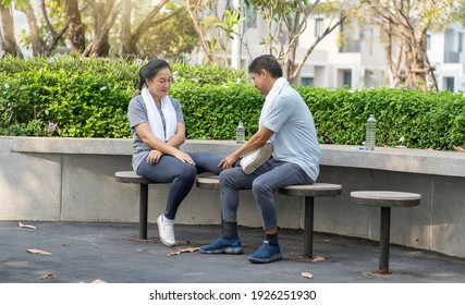 Elderly couple, senior woman running and falling, sore ankle, sitting rest, elderly men help with first aid at garden. Ankle sore health and sports `concept.