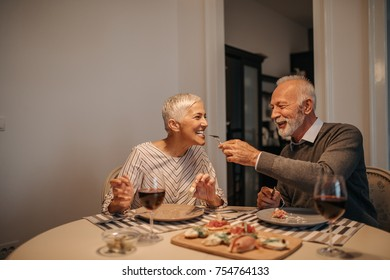 Elderly couple sharing food