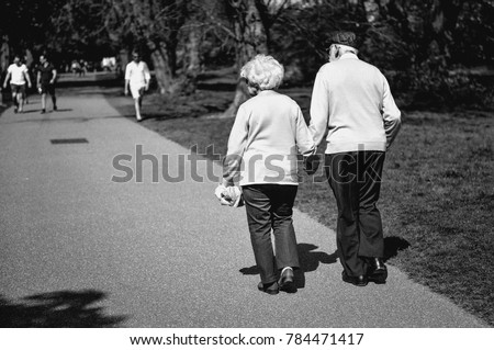 elderly-couple-strolls-through-park-450w