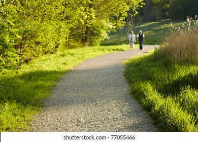 elderly couple take a stroll in the park