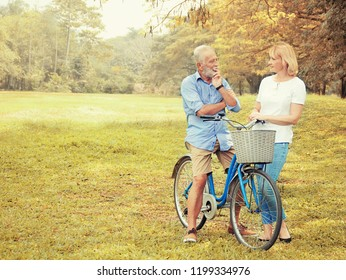 Elderly couple talking to each other in a beautiful park.