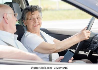 elderly couple travelling