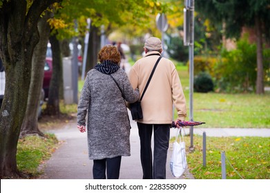 Elderly couple walking in the city.