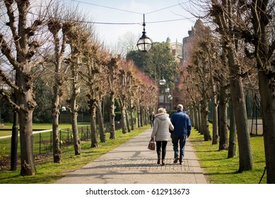 Elderly couple walking through a park in Windsor, England.