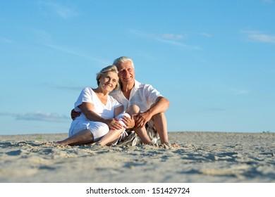 elderly couple went to the beach to enjoy the sea breeze