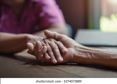 Elderly couples are holding hands, Concept of take care together.