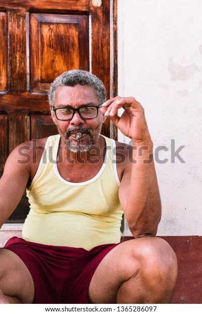 f61e38804 Elderly Cuban Man Smoking Cigar Front Stock Photo (Edit Now) 1365286097