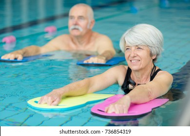 elderly doing aqua exercises in the pool