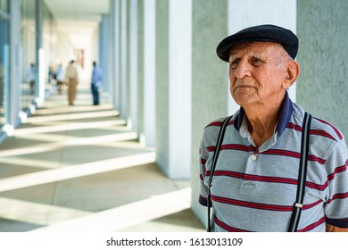 Elderly eighty plus year old man in a medical building setting.