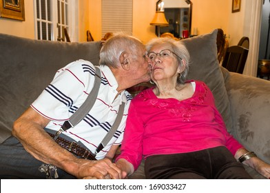 Elderly eighty plus year old couple in an affectionate pose.