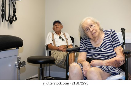 Elderly eighty plus year old handicap woman in a medical office setting.