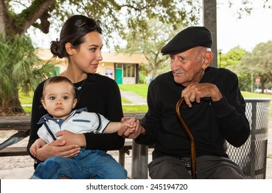 Elderly eighty plus year old man with granddaughter in a outdoor setting.