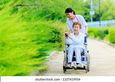 Elderly female wheelchair and caregiver