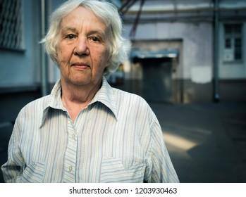 Elderly gray pensive woman on a walk