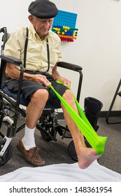 Elderly handicapped eighty plus year old man in physical therapy.