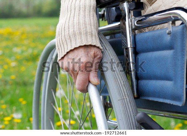 Elderly handicapped woman sitting in a wheelchair