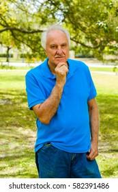 Elderly handsome man outdoor portrait.