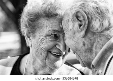 Elderly happy couple face to face. Love concept.