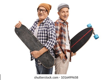 Elderly hipsters with a skateboard and a longboard looking at the camera and smiling isolated on white background