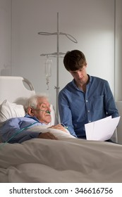 Elderly in hospital looking at lab test results
