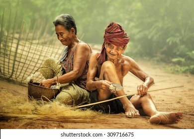 Elderly husband and wife working craft with bamboo.