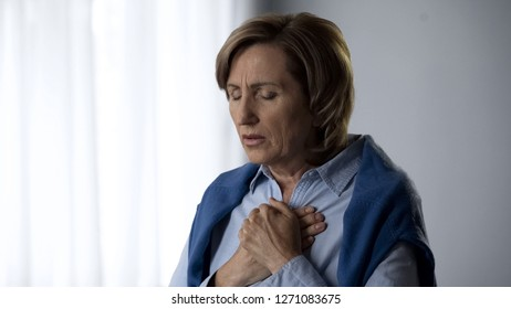 Elderly lady feeling anxiety, disturbed with bad news, emotional experience