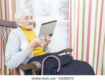 Elderly lady getting used to new technology.