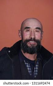 Elderly man bald head and a beard.asians