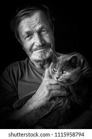 elderly man with a cat in his arms