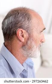 Elderly man with a deaf-aid