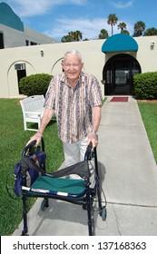 An elderly man with dementia enjoys the outdoors.