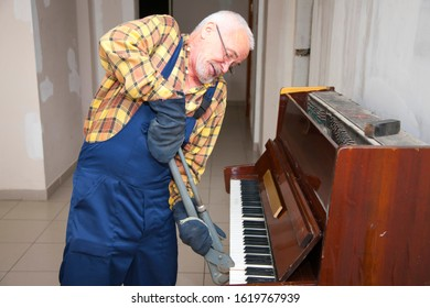 elderly man demount an old piano