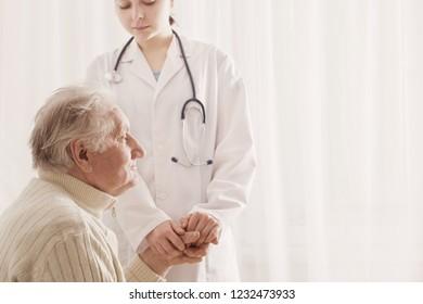 elderly man with doctor