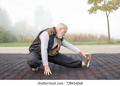 Elderly man doing physical exercise in the morning in park