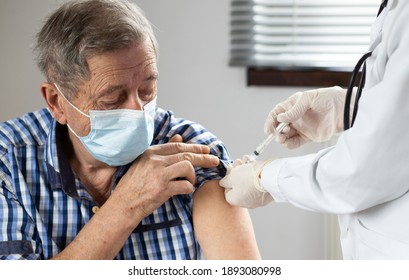 elderly man getting coronavirus vaccine