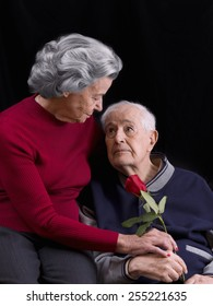 Elderly man, giving his wife a rose. Love in old age