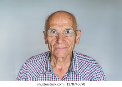 Elderly man with glasses