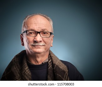 An elderly man with glasses looks skeptically