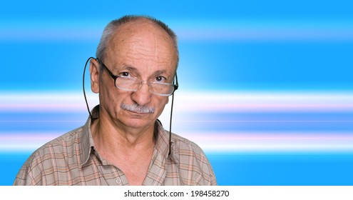 An elderly man with glasses on a blue abstract background