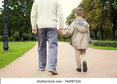 Elderly man with grandson in park