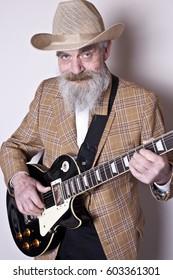 Elderly man with guitar