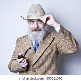 Elderly man at hat with  a tube
