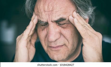 Elderly man having headache