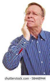 Elderly man holding hands to his aching mouth