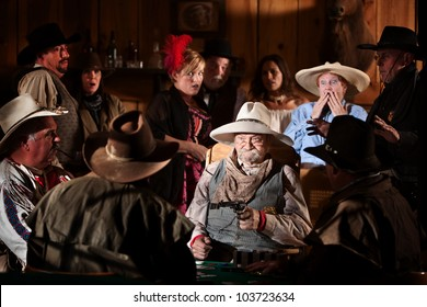 Elderly man holds up players in a poker game