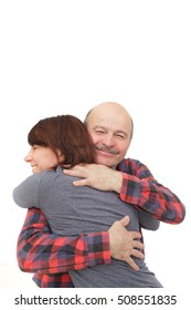 Elderly man hugging his daughter when meeting or parting. Good relations between parents and children
