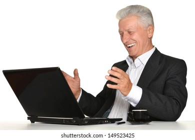 elderly man with a laptop on a white background
