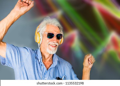 elderly man listen music with headphone and dance