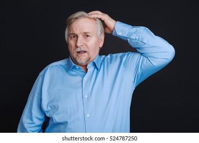 Elderly man looking disturbed