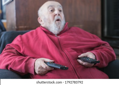 elderly man mesmerized by cable tv